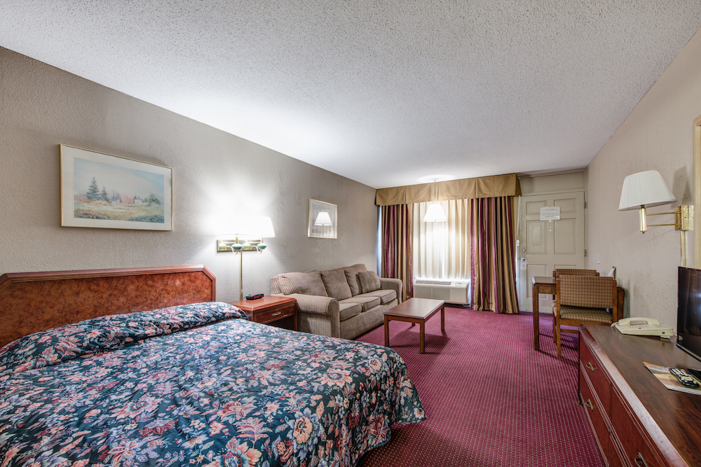 motel room with queen bed and sofa bed